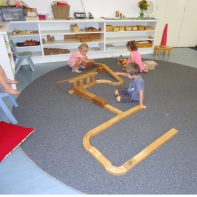 Playing with blocks on the circle mat